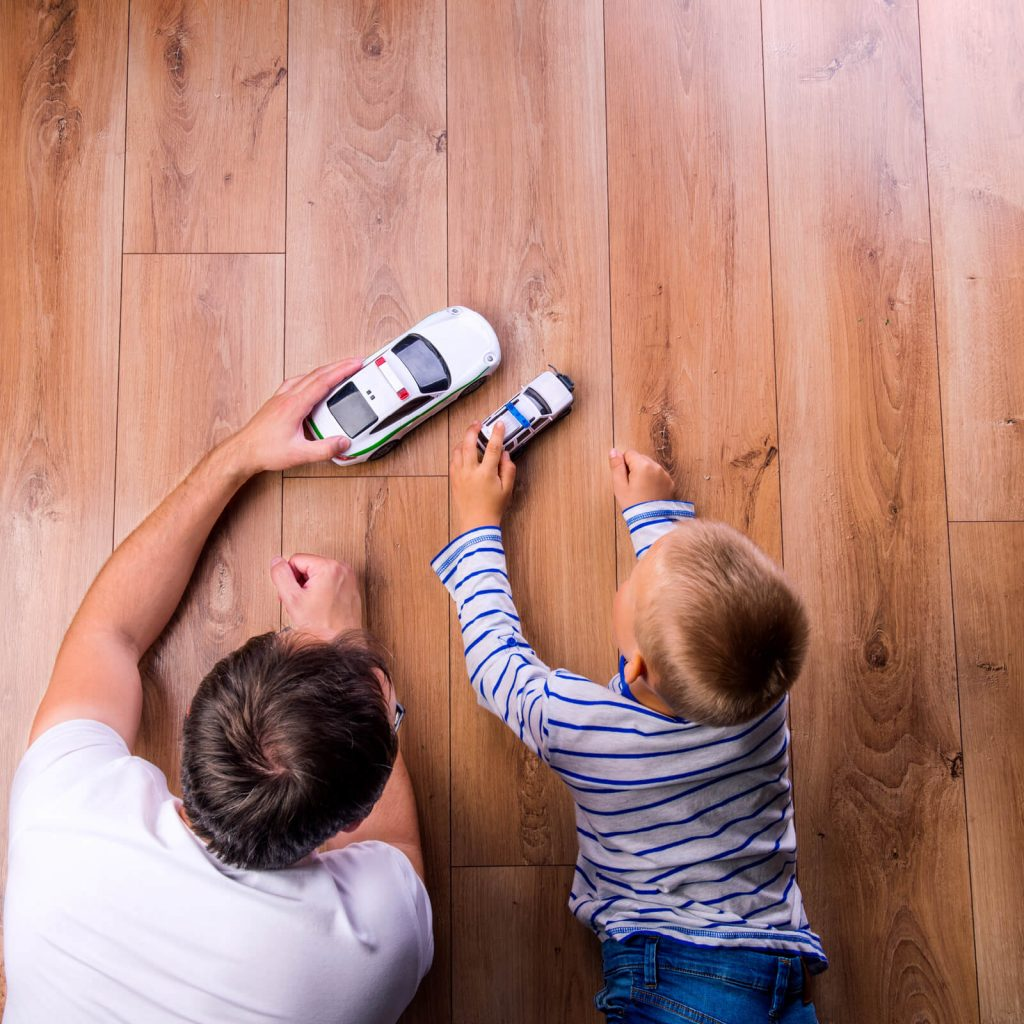 Father and kid playing with toycar