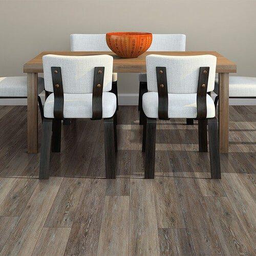 Dark wood vinyl plank under dining room table